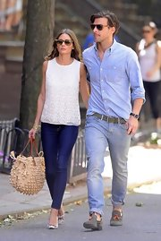 Olivia Palermo strolled through the West Village with beau Johannes Huebl in this white sleeveless blouse.