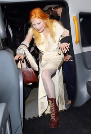 Vivienne Westwood wore a pair of brown lace-up boots with her evening dress at the Fashion for Relief charity dinner.