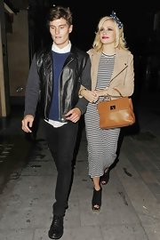 Pixie wore a nautical ankle-length dress for a night out in London.