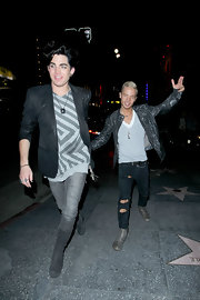 Adam wears a blazer with gray jeans and boots while out in Hollywood for his boyfriend's birthday.