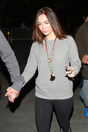 Megan Fox attended a Lakers' game looking ultra-casual in sweats and with her long tresses flowing.