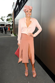 Playful yet elegant are two words to describe Ashley Hart's Melbourne Cup look as she wore a skirt with two uneven front slits and a satin top.