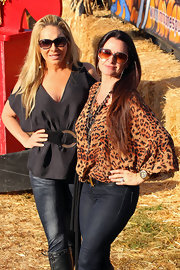 Adrienne Maloof bared some skin in a black deep-V tunic with shoulder cutouts during a visit to Mr. Bones Pumpkin Patch.