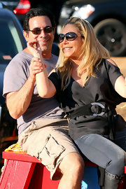 Adrienne Maloof accessorized with a chic pair of floating lens sunglasses during a visit to Mr. Bones Pumpkin Patch.