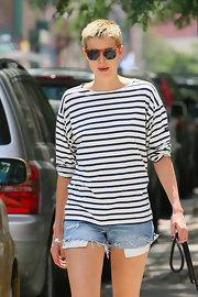 Agyness showed off her sporty shades while on a walk with her dog in the east village.
