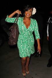 Niecy looks stylish in a green mod leaf print wrap dress for the 'Dancing with the Stars' party.