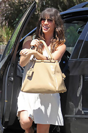 Alanis showed off her white summer dress, which she paired with a leather shoulder bag.
