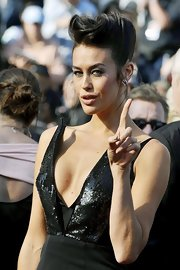 Megan Gale paired a pompadour with a fierce dress for a flamboyant look during the 'Mud' premiere in Cannes.