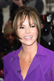 Long bangs and piecy layers on the sides framed Amanda Holden's face at the Palladium.