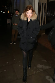 Geri Halliwell bundled up in a winter down jacket with fur trim.