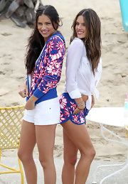 Adriana Lima was ready for the summer sun with this red and blue floral zip-up hoodie.