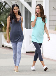 Alessandra Ambrosio was casual chic in a teal t-shirt on the set of a Victoria's Secret photo shoot.