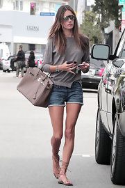 Alessandra Ambrosio showed off her muscular gams in a pair of denim shorts.
