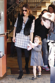 Alessandra made an unusual combination with this fur vest and plaid tunic.