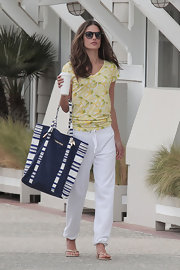 Alessandra Ambrosio looked read for the beach at a Victoria's Secret photo shoot where she showed off this cool navy beach tote with stripes.