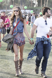 A sleeveless denim top was a fun and edgy choice for Alessandra Ambrosio at Coachella.