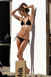 Alessandra Ambrosio showed off her svelte figure with this classic black string bikini.