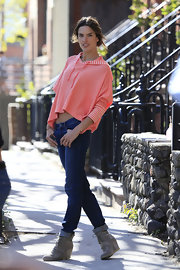 Alessandra Ambrosio posed in a peach-colored crop-top hoodie while at a Victoria's Secret photo shoot.