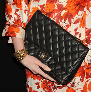 British model Erin O'Connor attended the Chanel Bijoux De Diamant 80th Anniversary party carrying a black leather quilted Chanel handbag as a clutch.