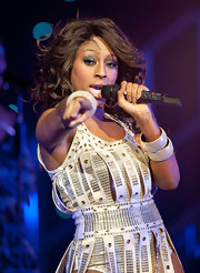 Alexandra Burke rocked the stage in Glasgow as part of her All Night Long tour. She spiced up her cascading curls with gunmetal silver shadow and a light nude lip.