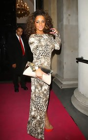 Chelsee Healey paired an slouchy oversized clutch with her wildly printed gown.