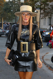 Anna dello Russo finished off her look with a summery straw hat.