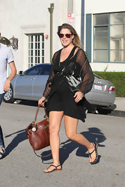 Ali Larter paired her comfy look with a tan leather shoulder bag.