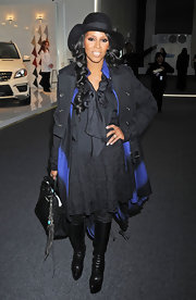 June Ambrose matched black with black as she carried a classic leather tote at the Zang Toi Fall 2012 event.