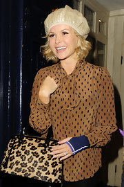 Amanda Holden wore a cream beret as she arrived at the theater.
