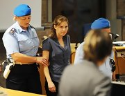 Amanda Knox wore a short-sleeved blue button down top while on trial in Perugia, Italy.