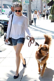 Amanda Seyfried took her dog for a walk in Beverly Hills wearing a pair of patterned ballet flats with bows.