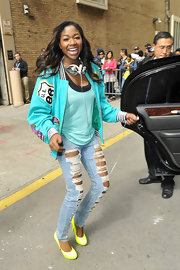 Amber Holcomb rocked this turquoise bomber with patches while out in NYC.