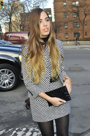 Amber Le Bon matched her checked dress with a croc-embossed envelope clutch at the Michael Kors fashion show.