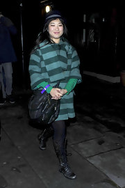 Jenna wore a striped wool coat with a bowler hat and combat boots. Quite an eclectic look!