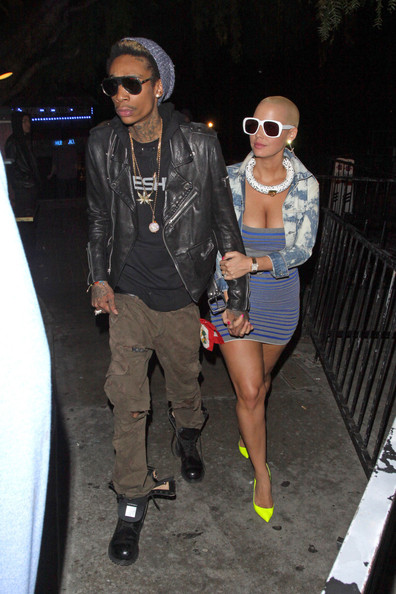 Amber Rose added a pop of color with neon stilettos.