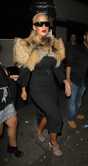 Amber Rose paired her black long sleeve jersey knit dress with a fur coat and leopard wedge heels.