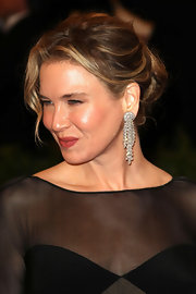 Renee Zellweger wore her shiny dark blond locks in an effortlessly chic 'do for the Met Gala.