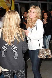 Alyson Michalka added texture to her casual Lakers attire with a furry shoulder flap back with a black leather tassel.