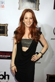 Amy Davidson kept a down-to-there-cut dress modest with a sequined bandeau top.