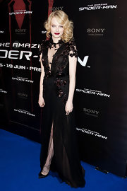 Emma Stone was a Gothic beauty at the Paris premiere in this sheer beaded black gown.