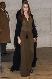 It really only seemed fitting that Angelina Jolie pair her maxi dress with a floor-length cape.