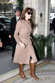Angelina Jolie embodied sophistication in a pair of tan leather knee high boots. A camel coat and Jackie O. style sunglasses complete the classy daytime look.