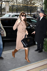 Angelina dons another fantastic coat. This classic camel color is super sophisticated with her knee high stiletto boots.