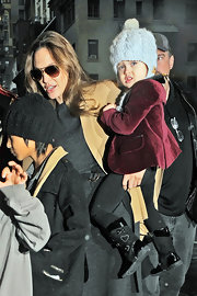 Vivienne Jolie Pitt's cable beanie was a cozy way to cover up.