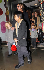 Maddox Jolie-Pitt paired gray cargo pants with a fleece jacket for a shopping trip with his family.