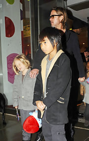 Maddox Jolie-Pitt cozied up in a two-tone fleece jacket while shopping for toys with his family.