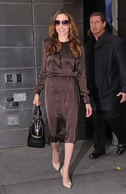 Angelina Jolie looked chic in New York wearing a chocolate silk dress with nude pumps.