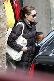 Angelina Jolie broke up her signature all-black look with a pristine white leather tote.
