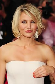 Cameron Diaz completed her elegant look at the London premiere of 'What to Expect When You're Expecting' with a pair of teardrop striped chalcedony and diamond earrings in 18-carat yellow gold.