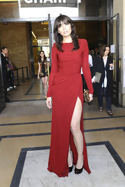 Daisy was ravishing at the Elie Saab Couture show in a long-sleeve draped red gown with a hip-high slit.